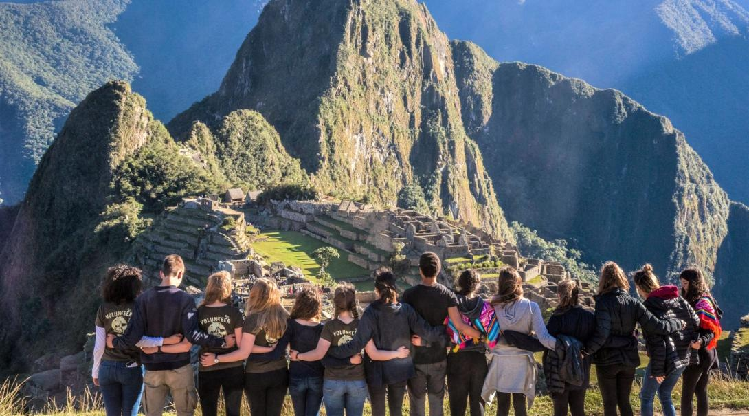 Projects Abroad volunteers admire Machu Picchu during a weekend trip as part of their Global Gap Trip.